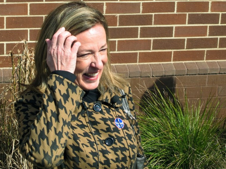 Elizabeth Colbert Bush, the sister of comedian Stephen Colbert, shares a laugh with reporters after voting in Mount Pleasant, S.C., on Tuesday, March 19, 2013.