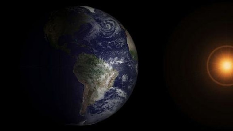 NOAA's GOES-13 satellite captured this image of the Earth at the spring equinox, Wednesday morning at 7:45 a.m. Eastern Daylight Time.