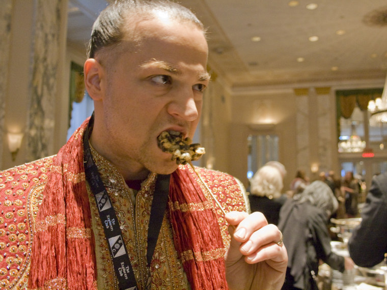 Baron Ambrosia shows us how to snack on fried tarantula.