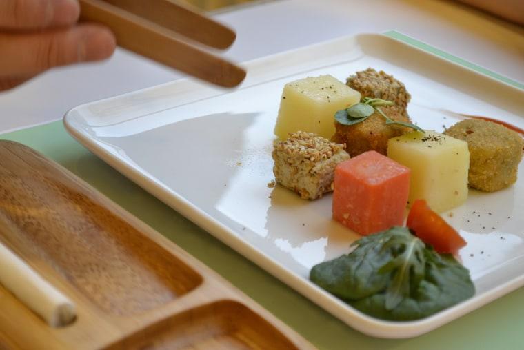 Sesame honey caterpillar mousse cubes, cricket croquettes and carrot and potato en glaze