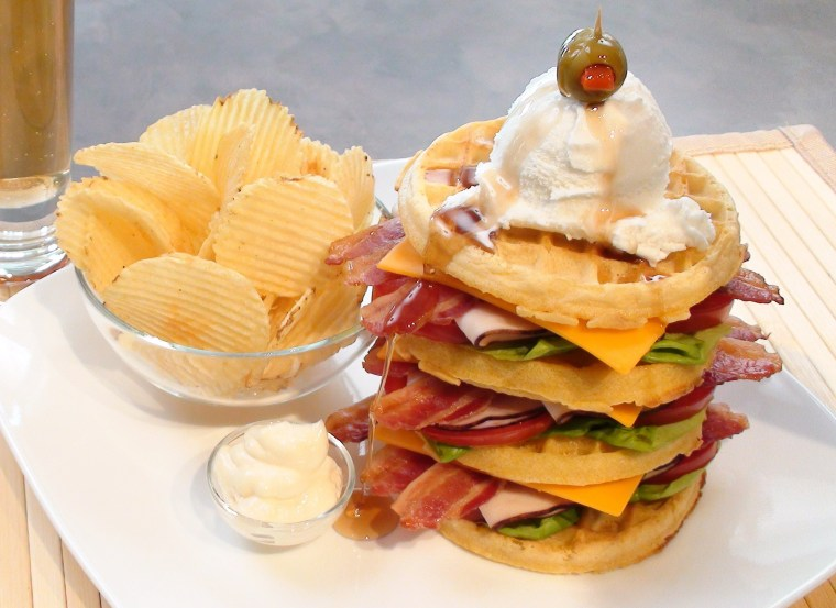 Who needs bread? The Breakfast Club is made with waffles, lettuce, tomato, turkey breast bacon and mayo, and is topped with vanilla ice cream and maple syrup.