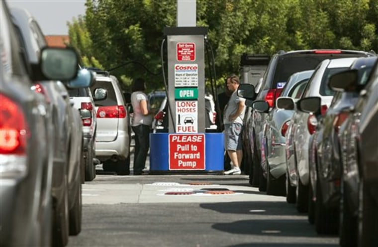 FILE - In this Friday, Oct. 5, 2012, file photo, Costco members fill up with discounted gasoline at a Costco gas station in Van Nuys, Calif. U.S. oil...
