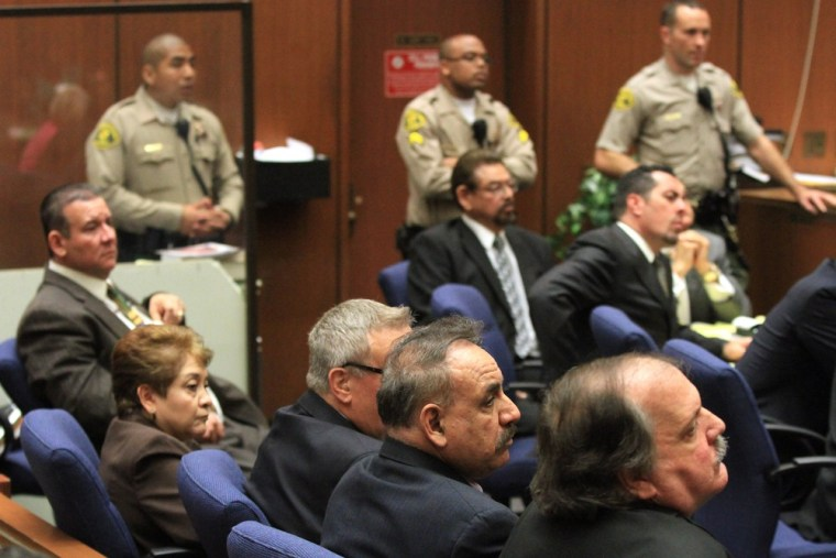 Five former Bell City Council members, shown in court on Wednesday, were found guilty of stealing public money by paying themselves extraordinary salaries in one of Los Angeles County's poorest cities. On Thursday, a mistrial was declared on the remaining counts.