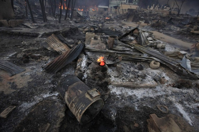 Burnt houses are seen in Meikhtila on March 21, 2013.