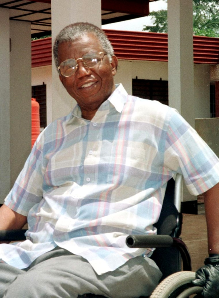 Author Chinua Achebe outside his home at Ogidi, eastern Nigeria, in 1999.