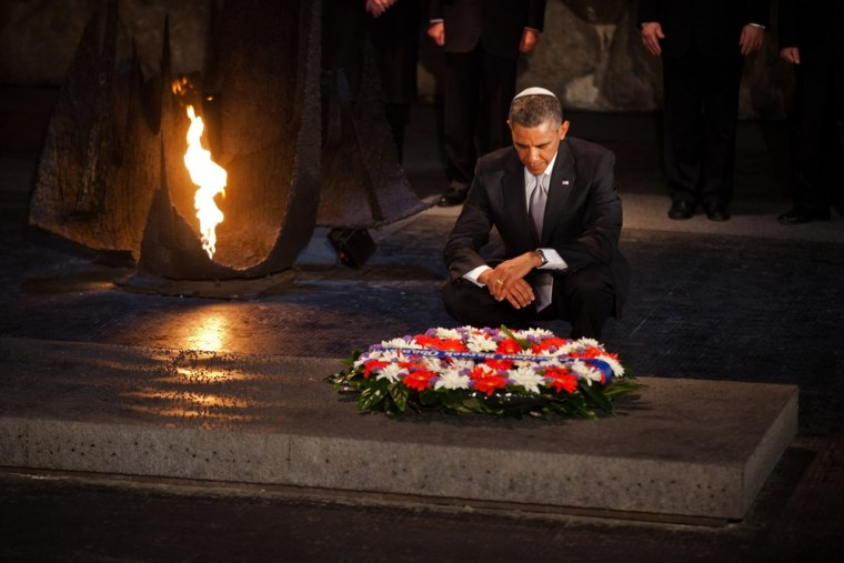 Obama pays his respects in the Hall of Remembrance at Yad Vashem after Marines laid a wreath on his behalf.