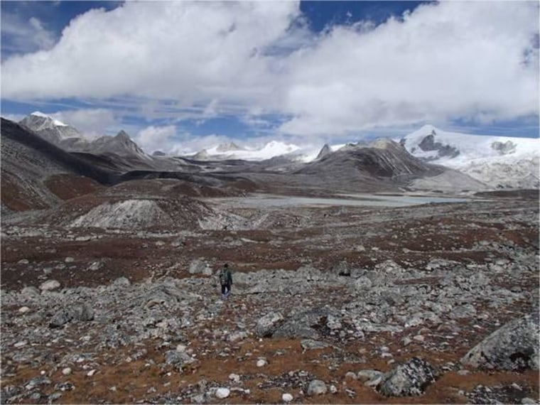 A hiker treks through Rinchen Zoe plateau in the Bhutanese Himalayas.