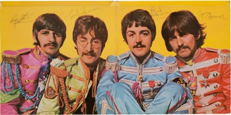"""The Beatles' """"Sgt. Pepper's Lonely Hearts Club Band"""" album autographed by all four members of the band."""
