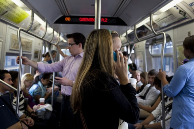 A commuter talks on her cellphone in New York, Sept. 23, 2011. In a study published March 13, 2013 in the journal PLoS One, scientists found t...
