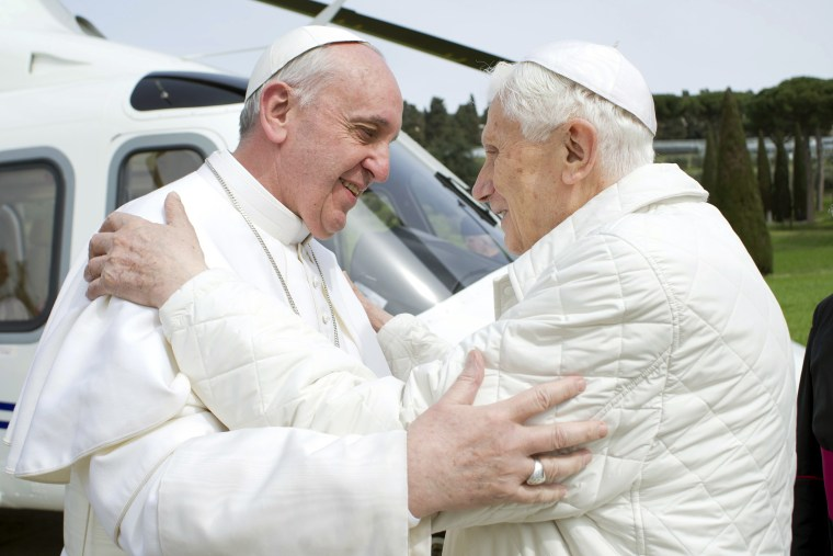 Pope Francis, left, embraces Pope Emeritus Benedict XVI as he arrives at the Castel Gandolfo summer residence March 23. Pope Francis traveled by helicopter from the Vatican to Castel Gandolfo for a private meeting with the former Pope Benedict XVI.