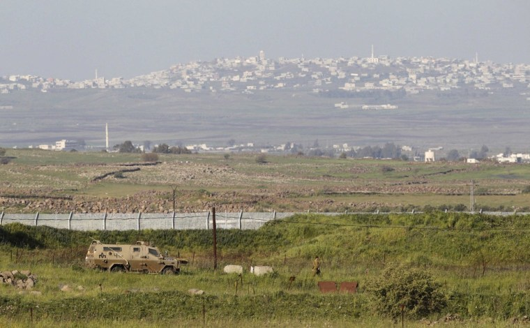 An Israeli armored vehicle is seen on the Israeli-Syrian border in the Israeli-occupied Golan Heights on Sunday.