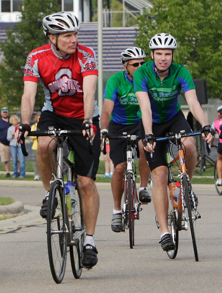 Sen. Rob Portman, R-Ohio, wearing the red jersey, riding in Columbus with his son Will in August 2012. Rob Portman said his views on gay marriage began changing in 2011 when Will, then a freshman at Yale University, told his parents he was gay.