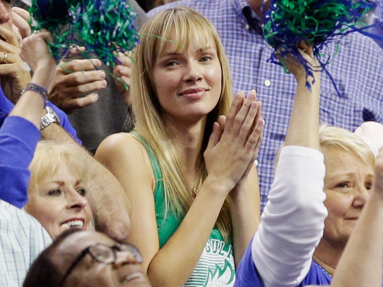 Amanda Marcum, the wife of head coach Andy Enfield of the Florida Gulf Coast Eagles, watches in the second half against the San Diego State Aztecs dur...