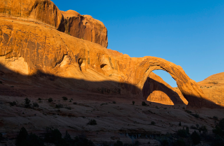 Corona Arch near Moab, Utah. The arch has become popular for adrenaline junkies seeking a thrill by swinging through the 140-foot sandstone arch.