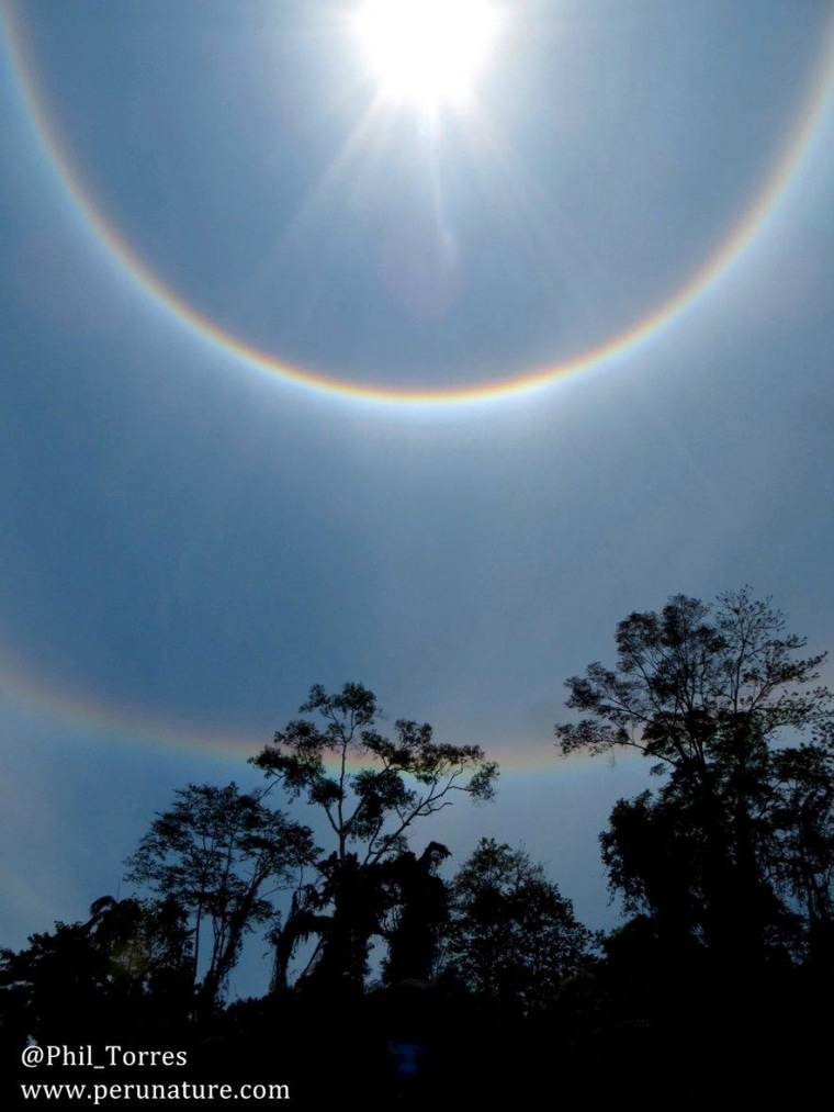 These amazing solar halos were spotted above the Tambopata River in Peru.