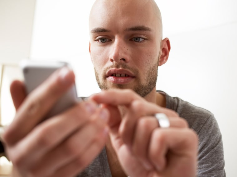 Man using his smart phone, msnbc stock photography