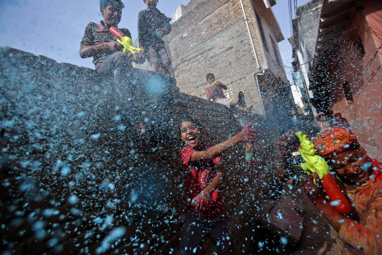 A boy sprays colored foam during Holi celebrations in a lane near the Bankey Bihari temple in Vrindavan, in the northern Indian state of Uttar Pradesh on March 26. Holi, also known as the Festival of Colours, heralds the beginning of spring and is celebrated all over India.