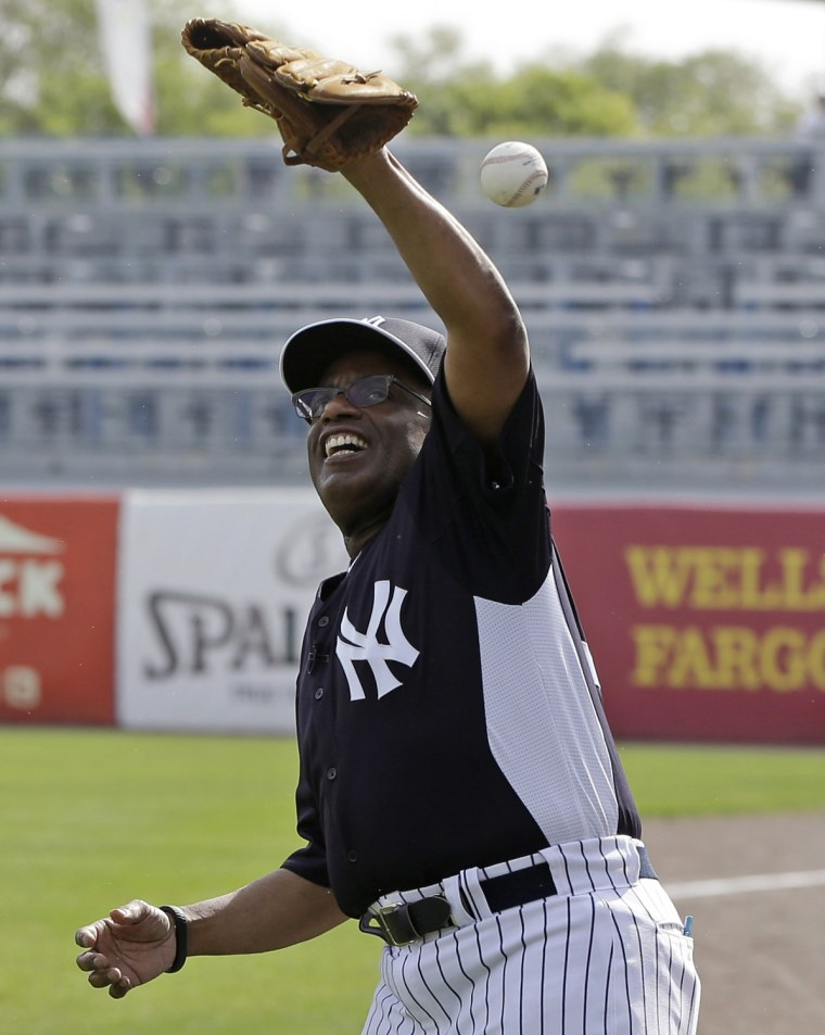 Al, clad in a Yankees uniform, misses a catch while playing toss with a coach on the field.