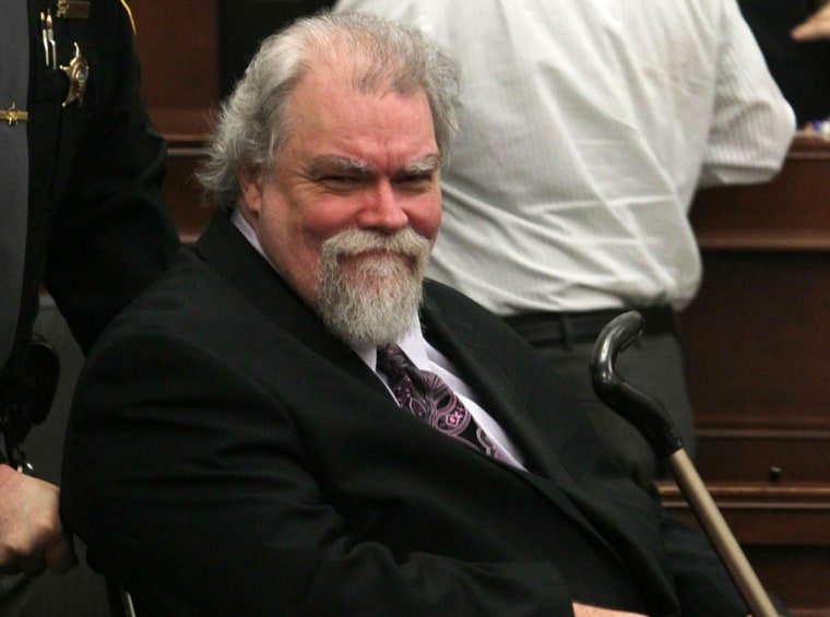 Richard Beasley smiles at his sister Sherri Beasley as he is wheeled into Summit County Common Pleas Judge Lynne S. Callahan's courtroom in Akron, Ohio, on Feb 27, 2013.
