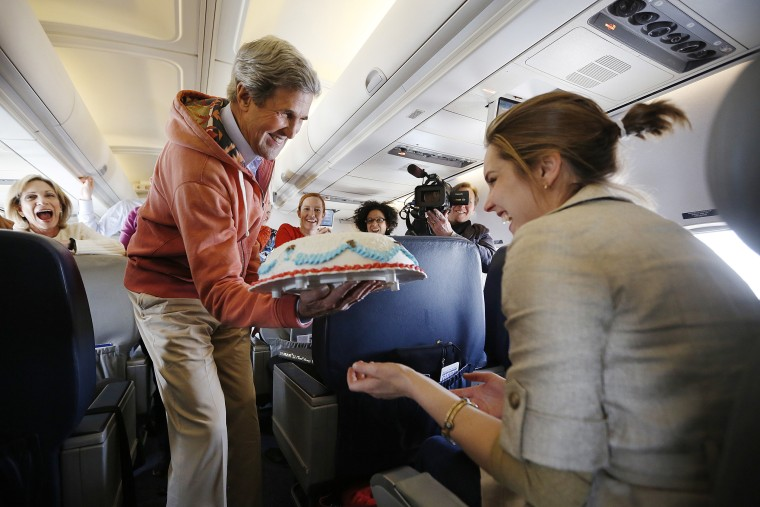 U.S. Secretary of State John Kerry presents a birthday cake to CBS correspondent Margaret Brennan on his flight from Kabul to Paris on March 26. Kerry held a second round of talks with Afghan President Hamid Karzai in Kabul on Tuesday after the two put on a public show of unity in a bid to repair damaged ties.