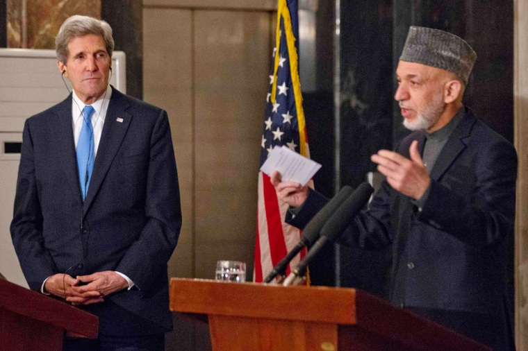 U.S. Secretary of State John Kerry, left, listens to Afghanistan's President Hamid Karzai during their joint news conference at the presidential palace in Kabul on Thursday, March 25, 2013.