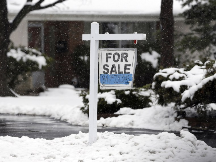 In this Wednesday, Feb. 27, 2013 photo, a for sale sign hangs outside a home in Glenview, Ill. Average U.S. rates on fixed mortgages were little chang...