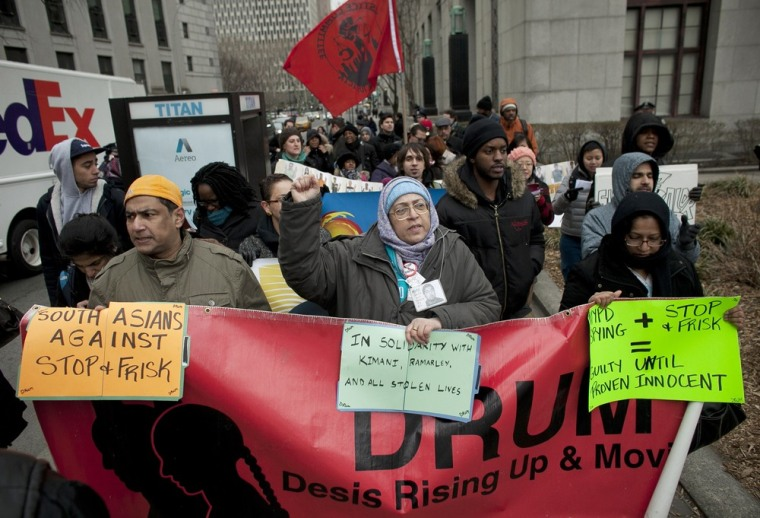People participate in a demonstration against the city's stop-and-frisk searches in lower Manhattan near federal court on March 18, 2013 in New York City, the day hearings began.