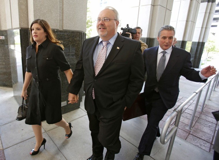 Former Florida GOP chairman Jim Greer, center, arrives at the Orange County Courthouse, with his wife Lisa, left, and attorney Damon Chase, right, for a sentencing hearing, Wednesday, March 27, in Orlando, Fla.