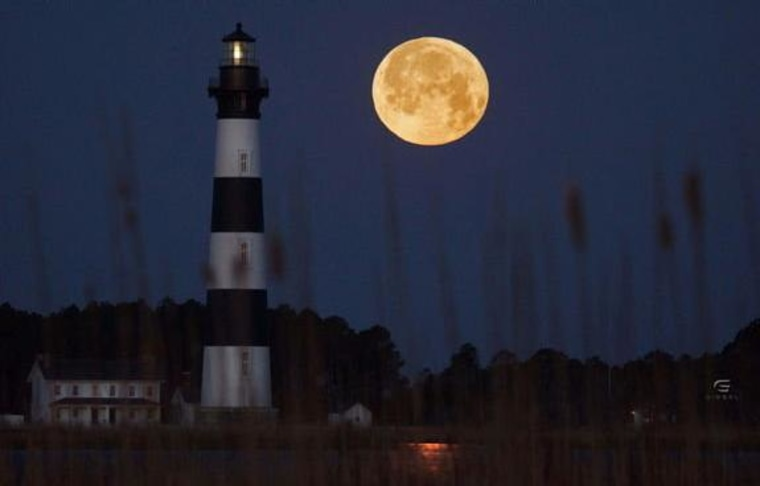 The 2013 March full moon hangs bright over the Bodie Island Lighthouse in Outer Banks, N.C., in this photo from Greg Diesel Walck.
