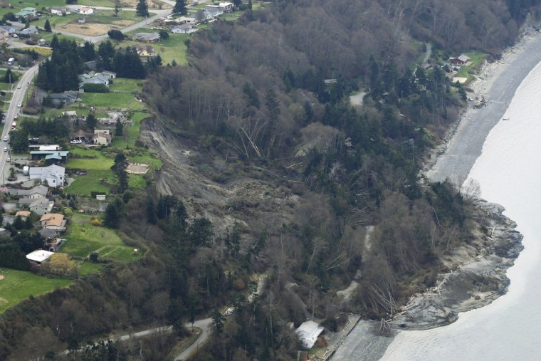 An aerial photo shows a landslide near Coupeville, Whidbey Island, Wash., on Wednesday. The slide severely damaged one home and isolated or threatened others.
