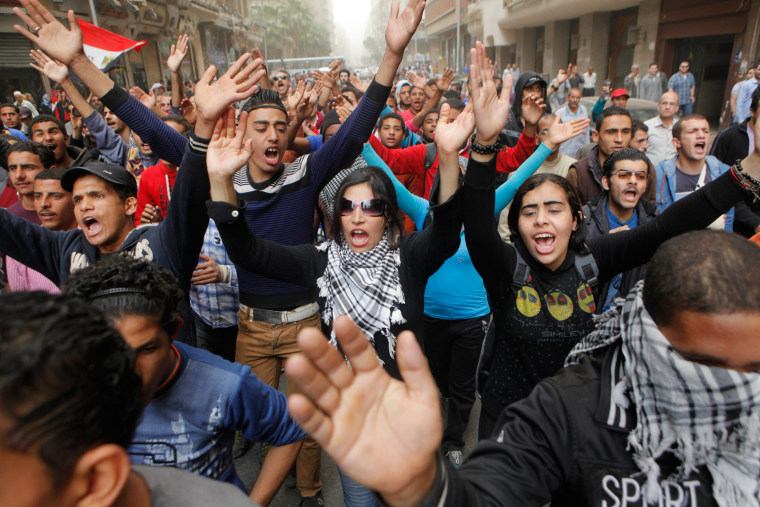 Egyptians shout anti-Muslim Brotherhood slogans during a march from downtown to the main Brotherhood headquarters in the hilltop neighborhood of Muqat...
