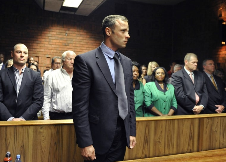 Olympian Oscar Pistorius stands following his bail hearing in Pretoria, South Africa, on Feb. 19.