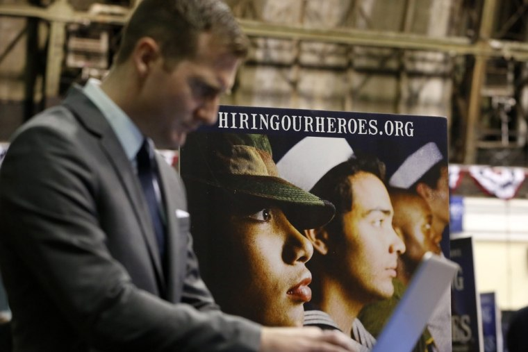 An attendee searches for a job listing during the 'Hiring Our Heroes' job fair in New York, March 27, 2013.