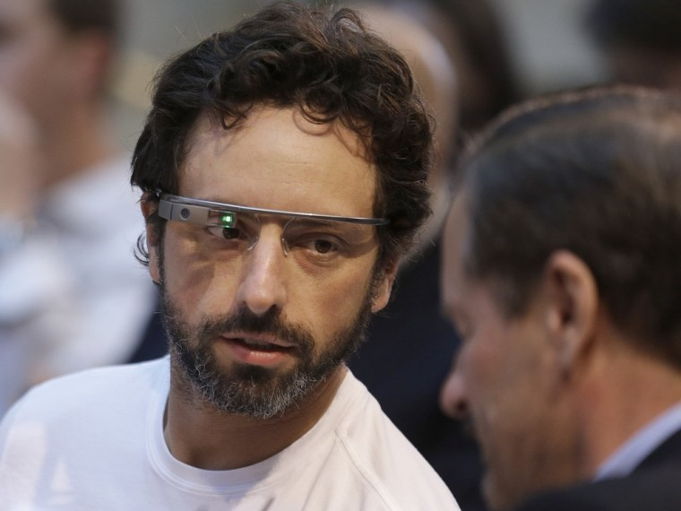 Google co-founder Sergey Brin, left, wears Google Glass.