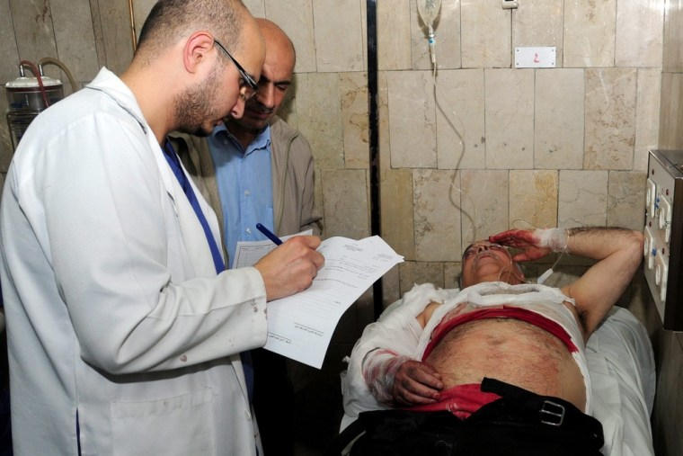 A wounded man receives medical treatment after a mortar attack on Damascus University, at Al Mouwasat hospital in Damascus, Syria, on Thursday. EDITOR'S NOTE: Photo distributed by the state-run Syrian Arab News Agency (SANA).