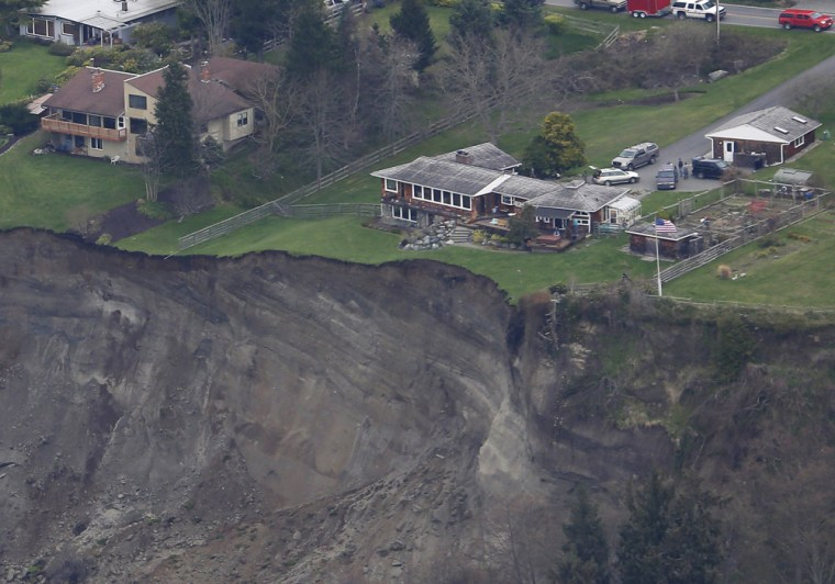 A house sits near the edge of a landslide, near Coupeville, Wash., on Whidbey Island, on March 27.