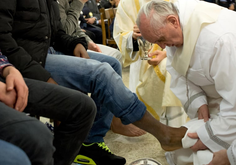 Pope Francis washes the feet of a young offender during a mass at the church of the Casal del Marmo youth prison on the outskirts of Rome as part of Holy Thursday on March 28.