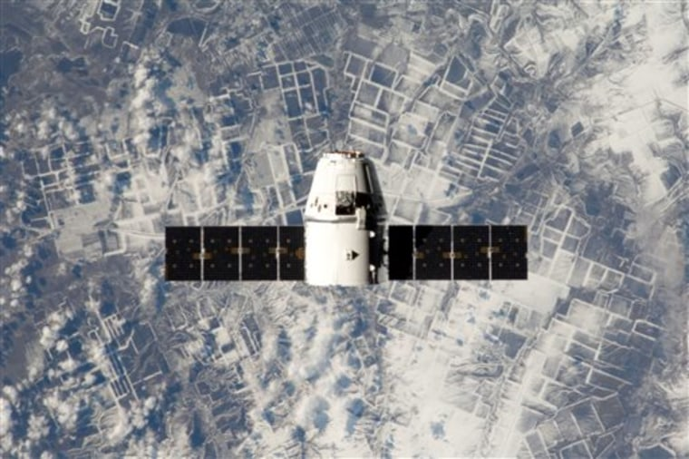 Commercial space efforts, such as the SpaceX program, with the Dragon capsule shown here, could be hurt by federal budget cuts, NASA Administrator Charles Bolden said Thursday.