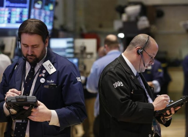 Image: Traders work on the floor at the New York Stock Exchange, March 28, 2013. REUTERS/Brendan McDermid