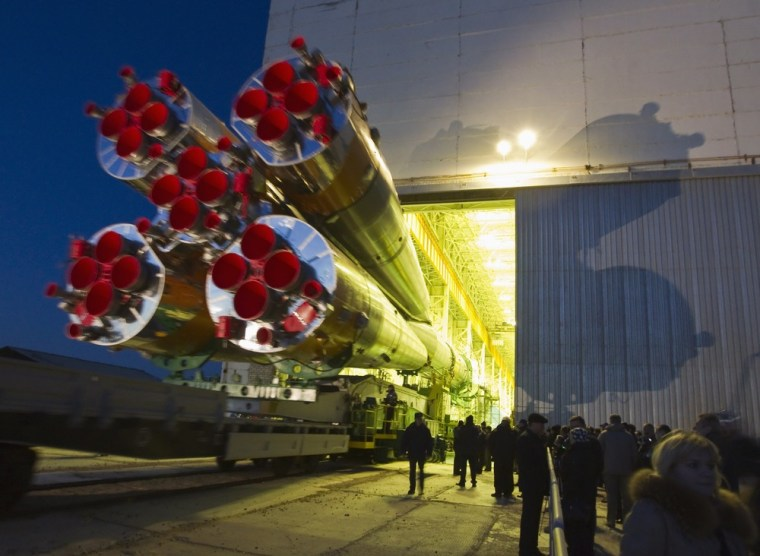The Soyuz TMA-08M spacecraft is transported from its assembly hangar to the launch pad at the Baikonur Cosmodrome on March 26.