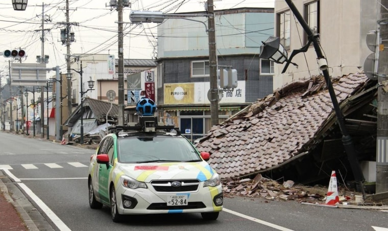 This March 2013 image released by Google shows its camera-equipped Street View vehicle as it moves through Namie in Japan, a nuclear no-go zone where former residents have been unable to live since they fled from radioactive contamination from the Fukushima Dai-ichi nuclear power plant two years ago.