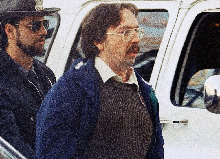 In this Dec. 17, 1993 file photo, Joel Rifkin, right, is led to the Nassau County Courthouse in Mineola, N.Y., for a suppression hearing. New Jersey State Police said Wednesday, March 27, 2013, that 25-year-old Heidi Balch likely was the first victim of Rifkin, who is in prison in New York after admitting he killed 17 women in the early 1990s.