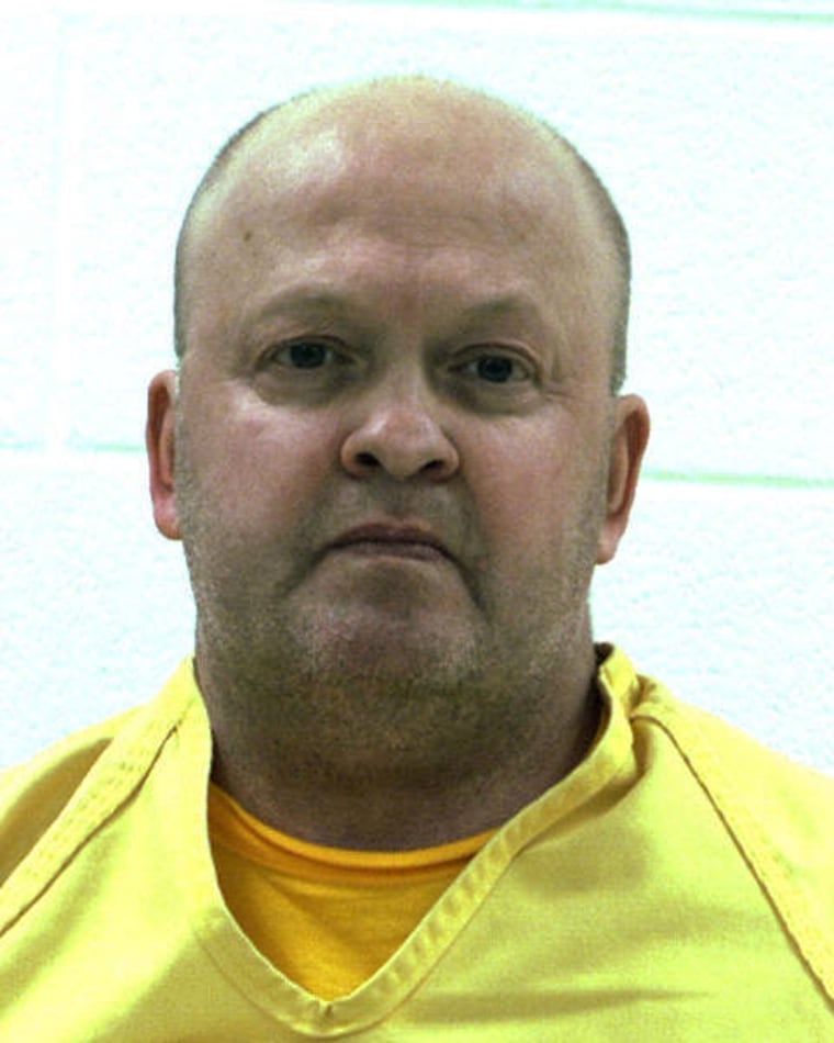 An undated booking photo released by the Centre County Correctional Facility in Bellefonte, Pa., shows Mark A. Miscavish. Miscavish, a former state trooper, killed his estranged wife with a shotgun inside a central Pennsylvania supermarket Thursday, March 28, 2013. and then killed himself.