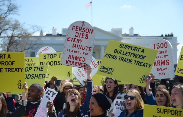 Demonstrators from Amnesty International call for a global arms treaty in a protest outside the White House, March 22.