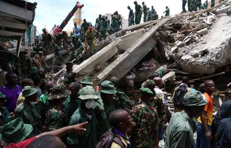 Rescuers search for survivors in the rubble of a collapsed building in the Kariakoo district of central Dar es Salaam, Tanzania on Friday.