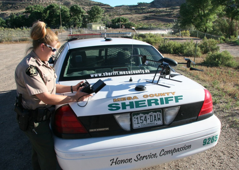 Deputy Amanda Hill of the Mesa County Sheriff's Office in Colorado prepares to use a Draganflyer X6 drone equipped with a video camera to help search for a suspect in a knife attack.