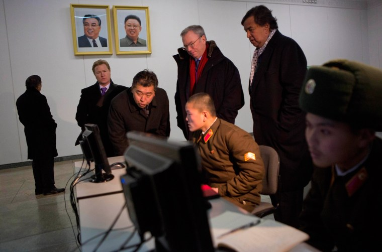Eric Schmidt, back row left, and former Governor of New Mexico Bill Richardson, back row right, look at North Korean soldiers working on computers at ...