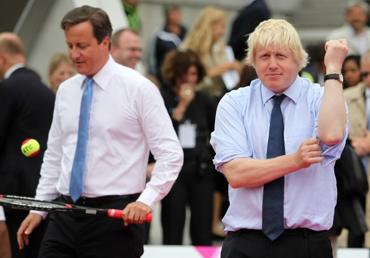 Britain's Prime Minister David Cameron and Mayor of London Boris Johnson warm up for a tennis match during the London Olympics.