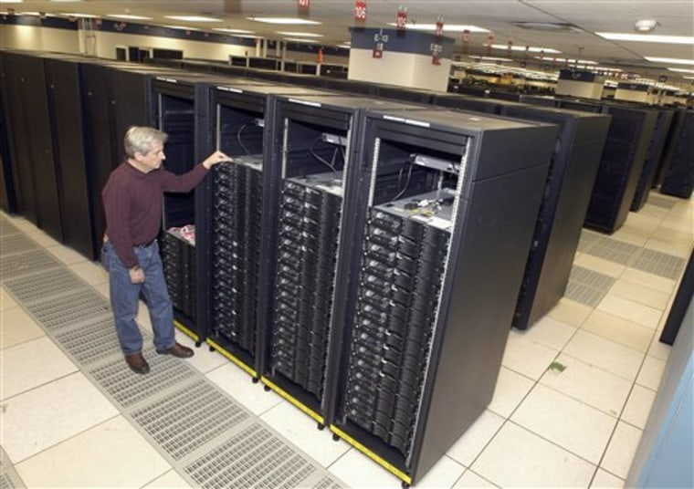 This undated handout photo provided by IBM shows lead engineer Don Grice of IBM inspecting the world's fastest computer, nicknamed