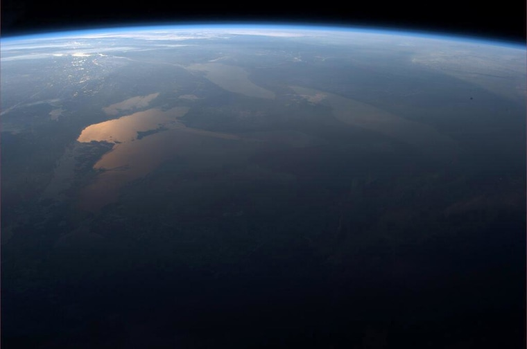 This Easter Sunday sunrise photo taken by Canadian astronaut Chris Hadfield on the International Space Station shows the Great Lakes region of North America on March 31, 2013.